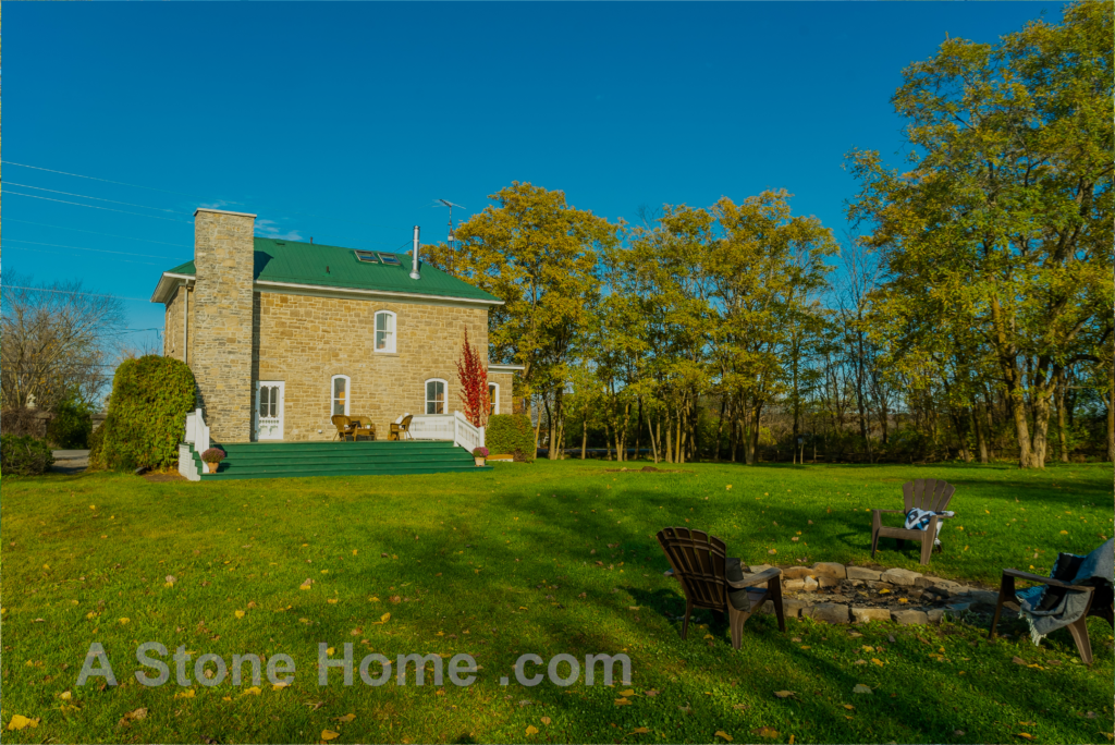Merrikville Ontario stone home for sale Dave Chomitz back elevation