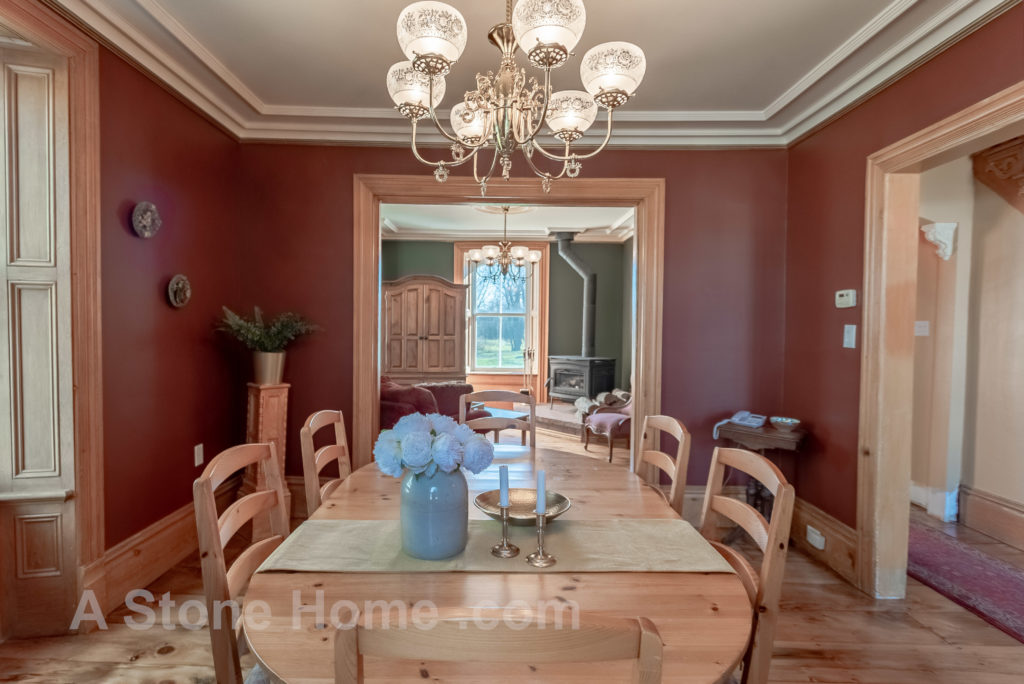 Merrikville Ontario stone home for sale Dave Chomitz dining wood trims