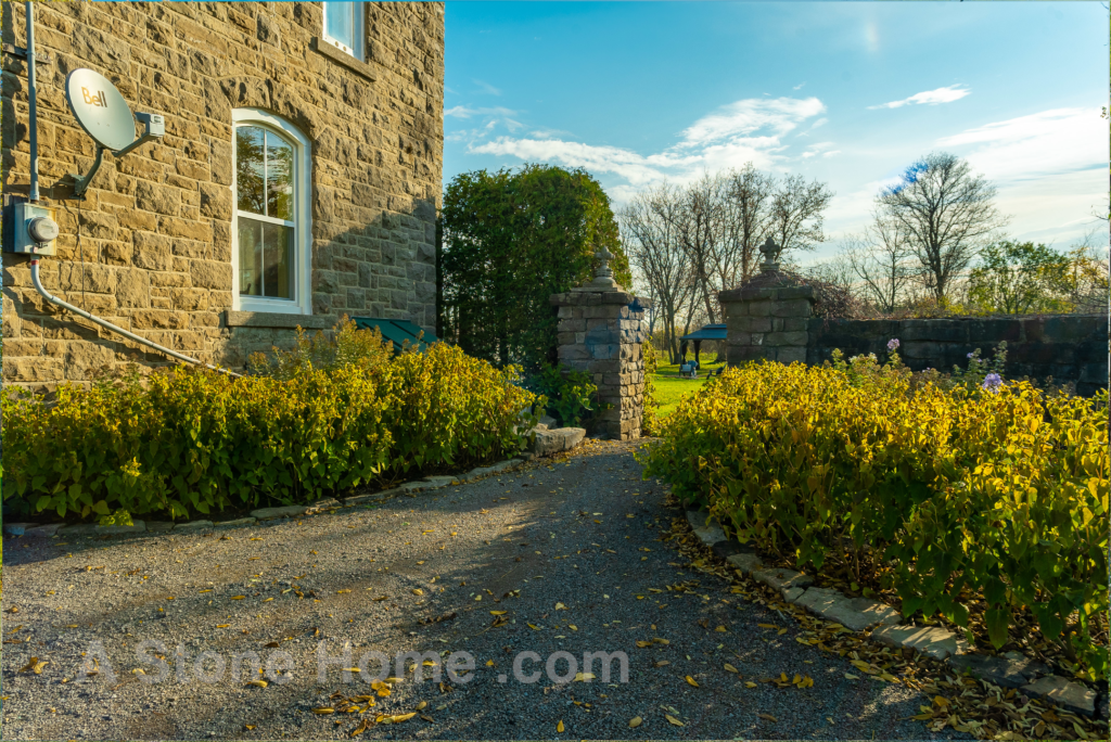 Merrikville Ontario stone home for sale Dave Chomitz side yard